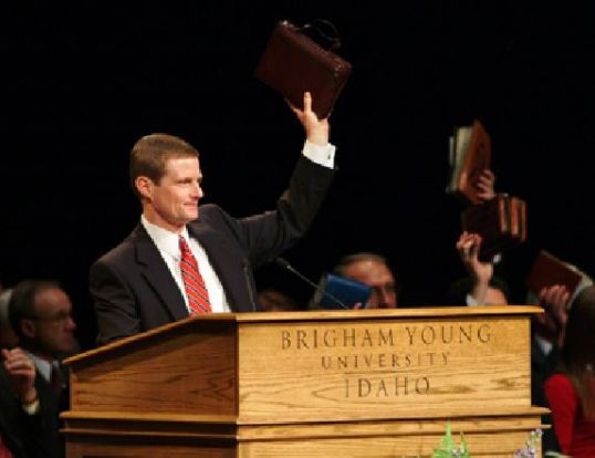President David A Bednar of BYU Idaho holding up his scriptures during a 2004 campus devotional.