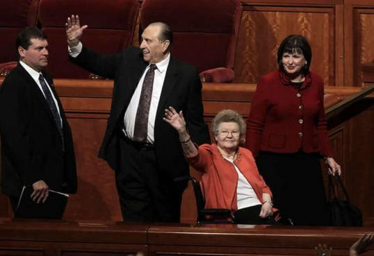 President Thomas S. Monson and his wife, Frances, wave as they exit the conference center following the morning session of General conference Sunday, Oct. 7, 2012.
